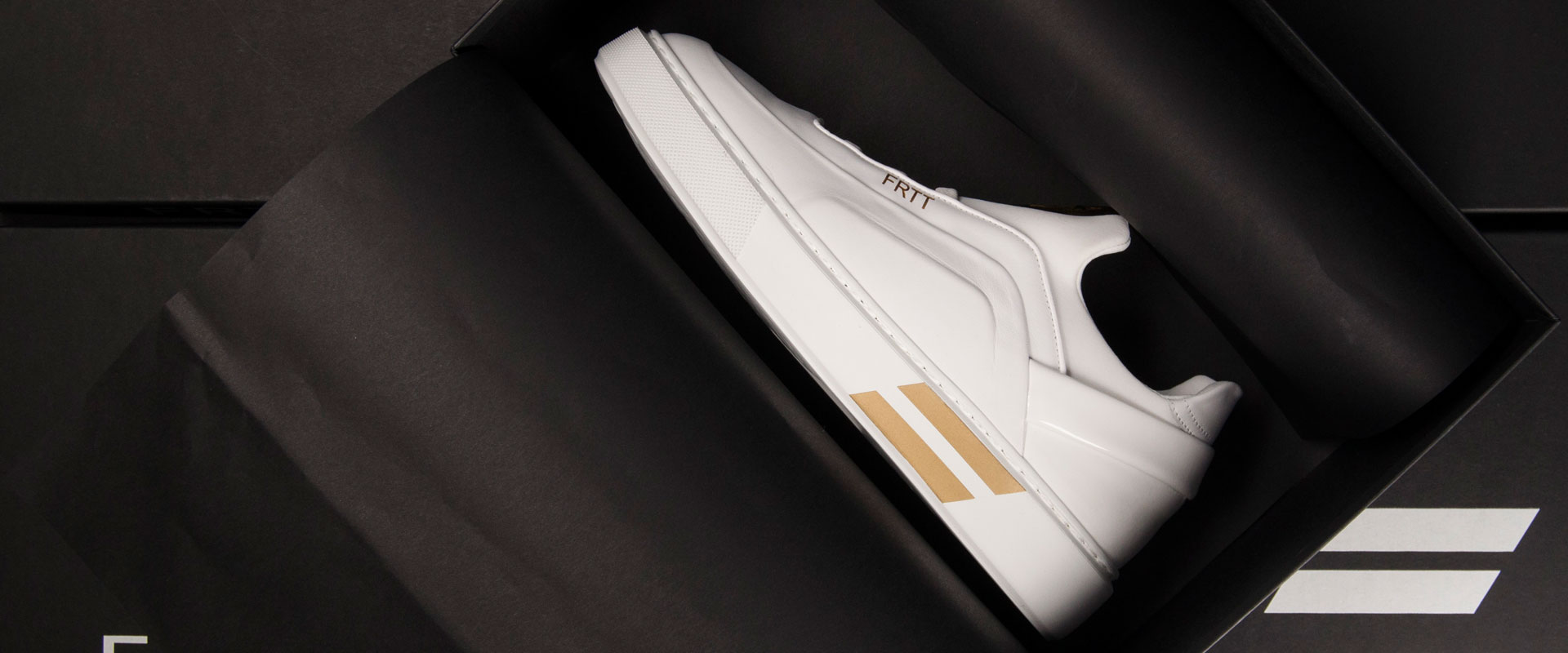 White sneaker with gold